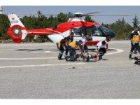 Ralli aracı Eskil'de devrildi, sürücü helikopter ambulansla Konya'ya getirildi